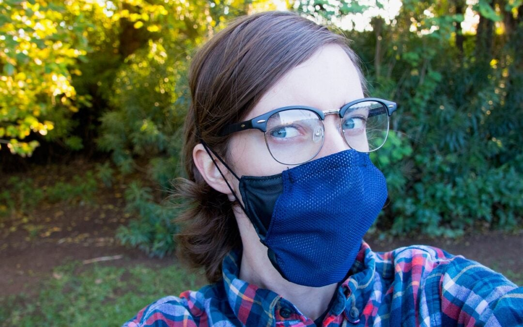 An ASU student models the COVID-19 mask created by the Luminosity Lab